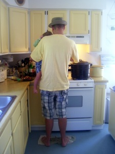 Teaching Son the joys of canning